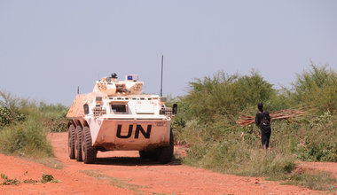 CHNBATT APC on perimeter road near the POC in Juba